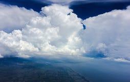 云彩在蓝天面对 库存图片