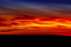 云彩由朝阳照亮在早晨 免版税图库摄影