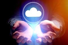 云彩飞行一个人- techno的手的存贮象的概念 免版税库存图片
