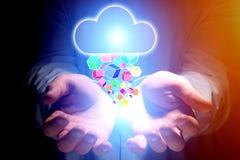 云彩飞行一个人- techno的手的存贮象的概念 库存图片