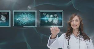 互动与医疗接口的妇女医生反对蓝色背景 免版税图库摄影
