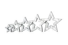 五个星变成银色被隔绝的白色 免版税库存照片