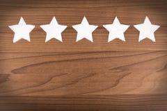 五个星在烹调背景的产品质量规定值 免版税库存照片
