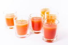 五个橙色蜡烛 库存图片
