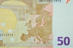 五十欧元钞票与欧洲地图的后面细节 免版税库存图片