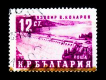五年计划显示水力发电的堰坝,工程师v Kolarov,大约1959年 图库摄影