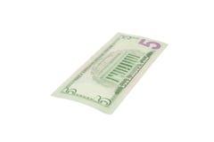 五美元在白色的美国货币 免版税库存照片