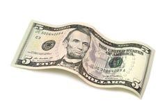 五美元滚动的票据  免版税库存照片