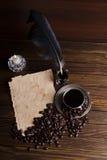 五谷和咖啡与一个蜡烛的 免版税库存图片