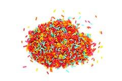 五颜六色为在白色背景隔绝的蛋糕洒 免版税库存图片