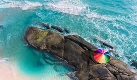 五颜六色在海滩的伞 库存图片