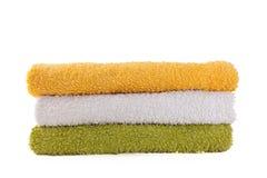 五颜六色的三块毛巾 免版税库存照片