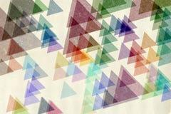 五颜六色的三角织地不很细纸 免版税库存照片