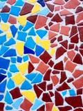 五颜六色的不规则的几何石墙纹理背景 免版税图库摄影