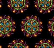 五颜六色的与花的坛场圆装饰在种族样式无缝的印刷品样式的装饰品和叶子导航例证 图库摄影