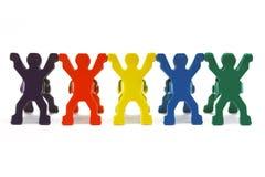 五颜六色的人型夹子 免版税库存照片