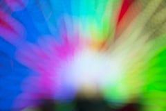 五颜六色的光抽象迷离bokeh在游乐园隧道里面的在晚上 免版税库存图片