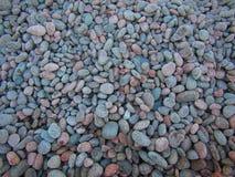 五颜六色的光滑的圆的石头 库存图片