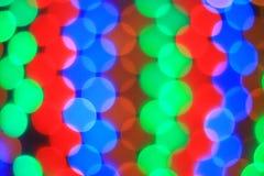五颜六色的光的被弄脏的图象 抽象空白背景圣诞节黑暗的装饰设计模式红色的星形 免版税库存照片