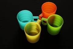 五颜六色的四个杯子 库存照片