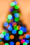 五颜六色的圣诞树点燃bokeh背景 库存照片