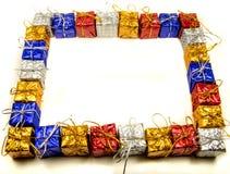 五颜六色的圣诞节礼物框架 库存照片