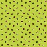 五颜六色的在浅绿色的背景的小点简单的无缝的样式 免版税库存图片