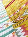 五颜六色的地毯背景划分成两个部分 库存照片
