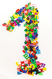 五颜六色的塑料信件和数字 免版税库存照片