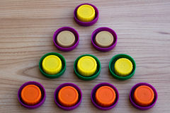 五颜六色的塑料盒盖三角  库存图片