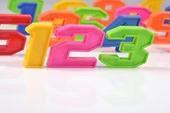 五颜六色的塑料第123在白色 库存图片