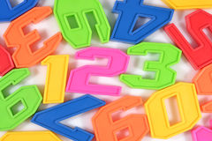 五颜六色的塑料第123在白色 免版税库存照片