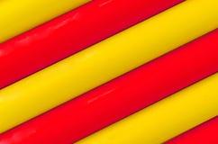 五颜六色的塑料管材样式纹理背景 库存照片