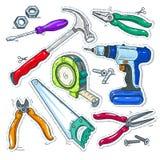 五颜六色的套木匠业工具、锤子、钻子和锯 免版税库存照片