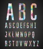 五颜六色的字母表由抽象几何形状做成 库存图片
