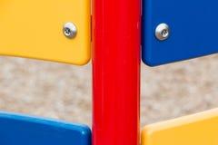 五颜六色的孩子操场设备 免版税图库摄影