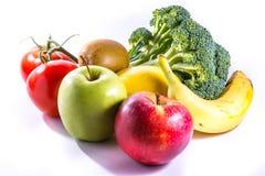 五颜六色的小组新鲜食品硬花甘蓝香蕉苹果猕猴桃蕃茄 库存照片