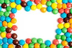 五颜六色的巧克力糖框架 库存照片