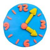 五颜六色的彩色塑泥黏土时钟 免版税库存照片