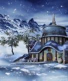 五颜六色的房子在冬天 免版税库存图片