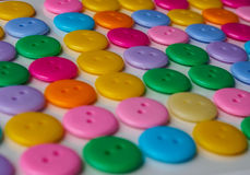 五颜六色的按钮行  图库摄影