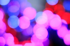 五颜六色的摘要弄脏了夜背景的城市街道圆bokeh光  图形设计和网站模板 库存照片