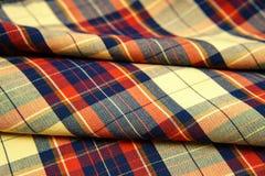 五颜六色的方格的衬衣当背景纹理,多彩多姿很好 免版税图库摄影