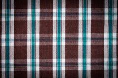 五颜六色的方格的衬衣当背景纹理 免版税库存图片