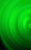 五颜六色的旋转辐形行动迷离抽象绿色背景  免版税图库摄影