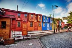 五颜六色的无背长椅房子 图库摄影