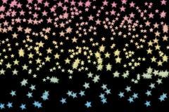 五颜六色的星做了n黑背景 免版税库存照片