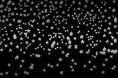 五颜六色的星做了n黑背景 免版税图库摄影