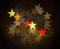 五颜六色的星Bokeh 免版税库存照片