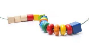 五颜六色的木小珠玩具 免版税图库摄影